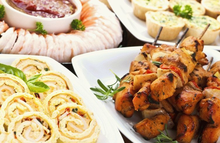 Many dishes of bite size appetizers and party food