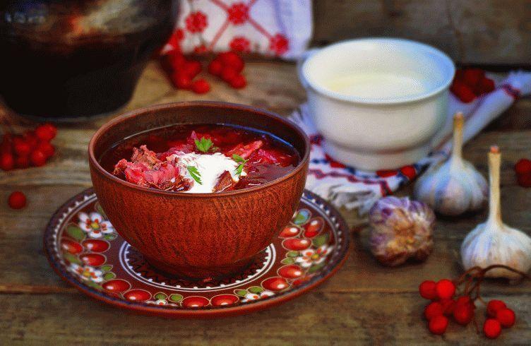 borsch, traditional Ukrainian beet and sour cream soup in a ceramic bowl