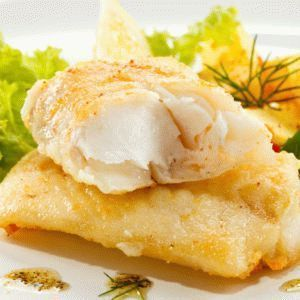Fried cod fillets and vegetables